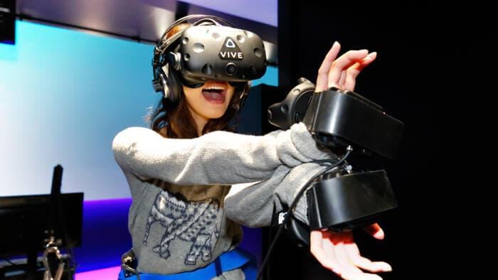 Woman playing VIVE VR Gear at VR Zone Shinjuku